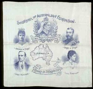 White linen handkerchief with decorative border woven into the fabric, printed images and text in blue. At the centre top, a portrait of Queen Victoria wearing a crown. She is flanked by portraits of the Duke and Duchess of York, c 1901. In the centre, maps of Australia and New Zealand with State borders defined and labelled. In the bottom left, a portrait of Lord Hopetoun, Australia's first Governor General, with Lady Hopetoun in the bottom right. Text across the centre.  [Photo courtesy of the National Library of Australia, image number oai.museum.vic.gov.au.247021]