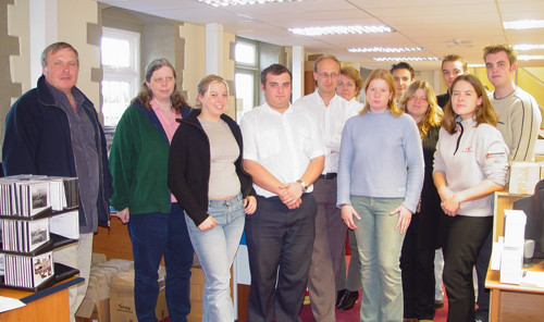 Nigel and Sue Bayley (on the far left), together with their staff in 2002