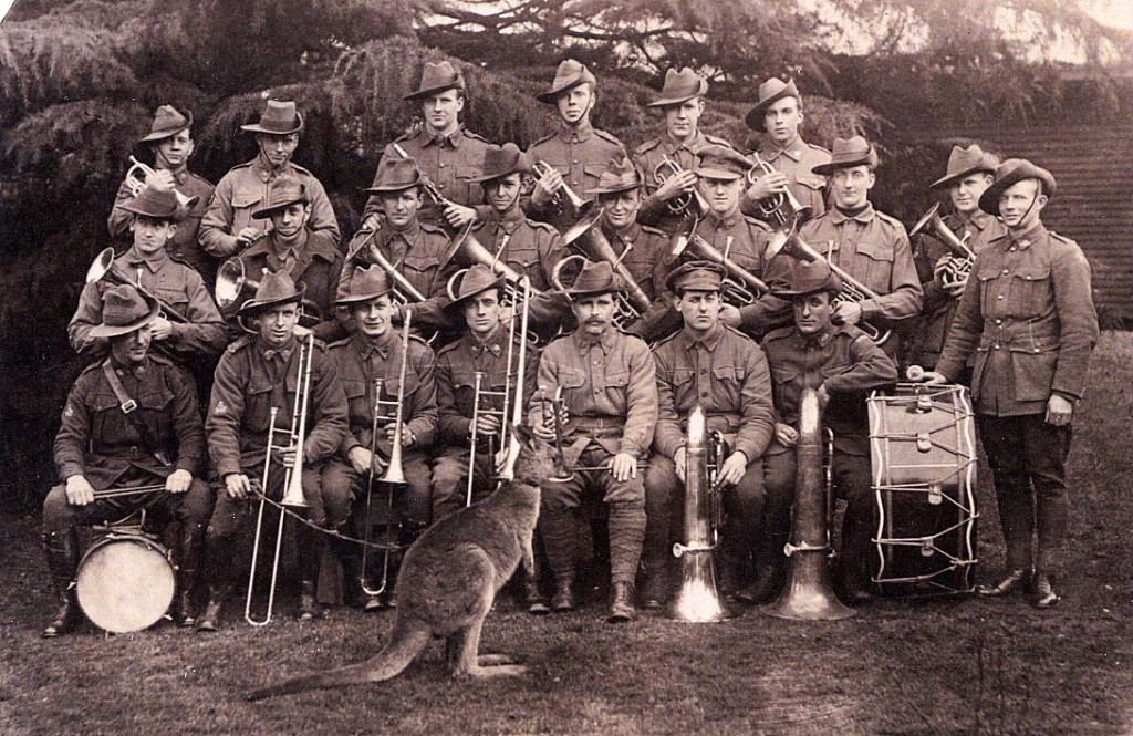 Harefield, England. The Australian Brass Band at No. 1 Australian Auxiliary Hospital, Harefield, England, with their pet kangaroo, Jimony. The bass drum shown in the photo is very similar to, and possibly is, the bass drum in the possession of the Footscray-Yarraville City Band. [AWM H19084]